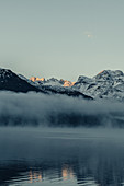 Lake Silvaplana at fog in the sunrise in the Upper Engadine, Sankt Moritz im Engadin, Switzerland