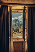 View from the window of mountains in autumnal Maloja, Upper Engadine, Engadine, Switzerland, Europe