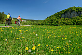 Man and woman ride a bike through the Danube Valley, Danube Valley, Danube Cycle Path, Baden-Württemberg, Germany