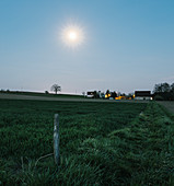 Rising moon over meadows and fields, Niefern, Grand Est, Alsace, France