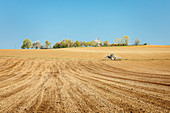 Tractor on arable field, Niefern, Grand Est, Alsace, France