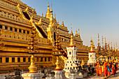 Monks at the golden Shwezigon Pagoda, Bagan, Myanmar