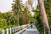 Cyclists on an idyllic path through the nature of Koh Kret, Bangkok, Thailand