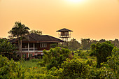 View of house in nature at sunset on Koh Kret, Bangkok, Thailand