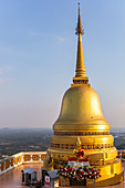Golden pagoda on Tiger Cave Mountain in the evening light, Tiger Cave Temple, Krabi Town, Thailand