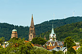 City view with Freiburg Minster and wind turbines, Freiburg im Breisgau, Black Forest, Baden-Württemberg, Germany