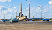 """Vintage cars at the """"Monumento al Maine"""" on the Malecon waterfront. Old Havana, Cuba"""