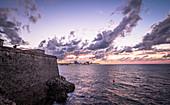"""View from """"Castillo de los Tres Reyes del Morro"""" fortress on Havana at sunset, Havana, Cuba"""