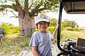 smiling 6 year old boy , Baines Baobab, Botswana