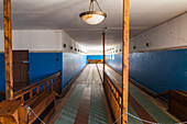 Bowling alley in ghost town Kolmannskuppe on tour on Wednesday, near Lüderitz, Namibia