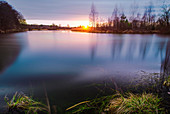 A pond in the west of Munich in the evening mood. Munich, Upper Bavaria, Bavaria, Germany, Europe