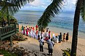 Wedding ceremony overlooking the Pacific Ocean on Savusavu Beach, Fiji Islands