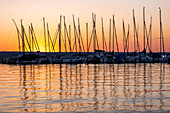 View of sailing boats on Lake Ammer at sunset, Bavaria, Germany, Europe