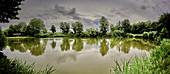Fishing in a thunderstorm, Dorum, Lower Saxony, Germany