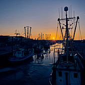 Sunset at the fishing port, Dorum, Lower Saxony, Germany