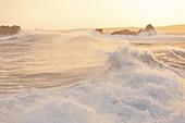 Huge waves at sunrise during storm Ciara raging on Cap de la Hague, Auderville, Cotentin Peninsula, Normandy