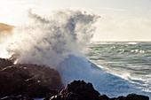 Waves at Goury Harbor on the northern tip of the Cotentin Peninsula, Normandy France.
