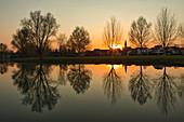 Sunset at the landscape lake in Seinsheim, wine paradise, Kitzingen, Lower Franconia, Franconia, Bavaria, Germany, Europe