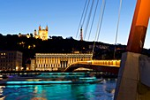 France, Rhone, Lyon, historical site listed as World Heritage by UNESCO, Vieux Lyon (Old Town), footbridge on the Saone river leading to the courthouse and the Notre Dame de Fourviere in the background