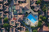 France, Var, Saint Tropez peninsula, Ramatuelle, Pampelonne beaches, Ramatuelle Holiday Village, swimming pool (aerial view)