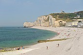 France, Seine Maritime, Etretat, Pebble beach and cliff of Amont overlooked by the church Notre Dame de la Garde