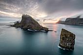 The islands of Drangarnir and Tindholmur at dusk, Vagar island, Faroe Islands, Denmark, Europe
