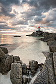 Lighthouse on cliffs during midnight sun, Eggum, Unstad, Vestvagøy, Lofoten Islands, Norway, Europe