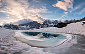 Forbici Lake in thaw during a spring sunset, Valmalenco, Valtellina, Sondrio Province, Lombardy, Italy, Europe