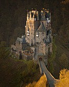View of the medieval Eltz castle by sunrise, captured from the hill above, illuminated from the first sunlight, Moselle River, Wierschem, Rheinland Pfalz, Germany, Europe