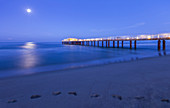 Dawn on Lido di Camaiore pier with moon, Lucca province, Versilia, Tuscany, Italy, Europe