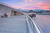 A tourist looks sunrise on Lido di Camaiore pier, Lucca province, Versilia, Tuscany, Italy, Europe