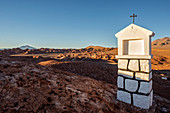 Tolar Grande, Salta province, Argentina, South America. A white chapel on a hill near the town