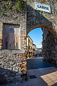Lazise sul Garda, Verona province, Veneto, Italy, Europe. The medieval door that marks the entrance to the town centre and an old mosaic