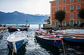Limone sul Garda, Brescia province, Lombardy, Italy, Europe. Typical wooden boats in the small harbour of Limone sul Garda