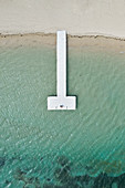 a vertical shot of a pier along a beautiful beach, Black River, Mauritius, Indian Ocean, Africa