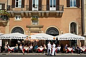 Italy, Lazio, Rome, historical centre listed as World Heritage by UNESCO, district of Navona Pantheon, Navone Place, consumers sat at the table in an outside café terrace in the shade of parasols