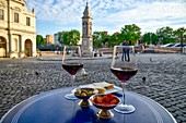 Italy, Lazio, Rome, historical centre listed as World Heritage by UNESCO, district of Campo di Fiori, Piazza di San Bartolomeo all' isola, glasses of wines with olives on a table on a paved place