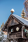 snow-covered wooden hut in Himmelberg, Carinthia, Austria