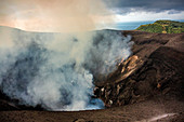 On the crater of the Yasur volcano on Tanna, Vanuatu, South Pacific, Oceania