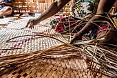 Woman braiding raffia mats, Malekula, Vanuatu, South Pacific, Oceania