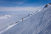 Ski tourers in the mountains of the Kitzbüheler Alpen when climbing in a steep snow field