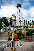 View of St. John the Baptist Church in Grainau, in the foreground a cross, Grainau, Bavaria, Germany, Europe