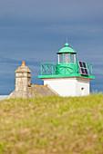 The lighthouse at Pointe de Saire above the dunes at Saint Vaast la Hougue, Cotentin Peninsula, Normandy, France