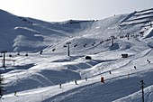 Ski slopes at the Pordoi Pass, ski lift, Dolomites, Trentino in winter, Italy