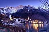 Alleghe with Monte Civetta, winter, lake, mirroring, church, hotels, evening, Belluno Dolomites, Veneto, Italy