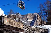 Paradis hut at Monte Civetta in the ski area Civetta over Alleghe, snow, skiers, ski slopes, chair lift, winter, Dolomiti Superski, Dolomites Veneto, Italy