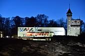 Museum der Moderne on Mönchsberg, evening light, blue sky, 2 buildings, tower, restaurant, Salzburg, Austria