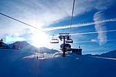 In the ski area Zauchensee, Sportwelt Amadé, mountains, chair lift, clouds, sky, ski slope, winter in Salzburg, Austria