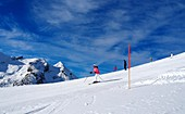 In Obertauern, ski area, pass, snow, sun, ski slopes, skiers, winter in Salzburg, Austria