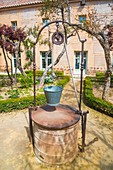 Well in a courtyard. Parador, Almagro, Ciudad Real province, Castilla La Mancha, Spain.